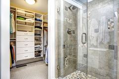 Modern bathroom interior with walk-in closet. Modern bathroom interior with glass door shower and walk-in closet royalty free stock photos
