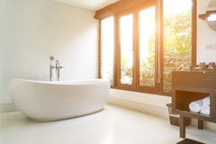 Modern bathroom interior with white oval bathtub stock images