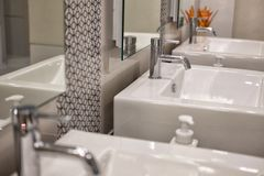 Modern bathroom interior. white washbasin sink & chrome faucet Royalty Free Stock Photo