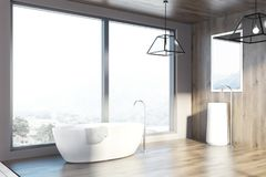 Loft wooden bathroom, tub and sink, side. Modern bathroom interior with a wooden floor and walls, a sink with a mirror and a white roundish tub near a loft royalty free illustration