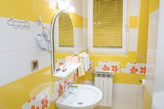Yellow bathroom interior royalty free stock photo
