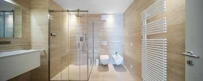 Modern bathroom with light marble i stock photography