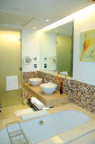 Modern bathroom in luxurious hotel Stock Images