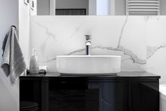Modern bathroom with marble finishing. In black and white style royalty free stock photography