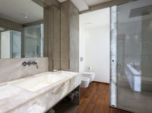 Modern bathroom with marble and parquet, nobody. Modern bathroom with marble and parquet Stock Images