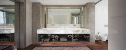 Modern bathroom with marble and parquet, nobody royalty free stock photography