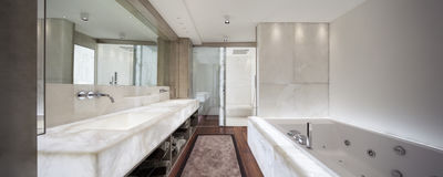 Modern bathroom with marble and parquet, nobody. Modern bathroom with marble and parquet Royalty Free Stock Photo