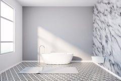 Modern bathroom marble walls and white tub Stock Photo