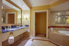 Modern bathroom with mirror two sinks jacuzzi bathtub taps for h Royalty Free Stock Image