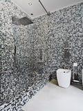 Modern bathroom with mosaic tile Stock Photos
