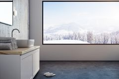 Modern bathroom with panoramic view. Modern bathroom interior with panoramic winter landscape view. Copy space and design concept. 3D Rendering Royalty Free Stock Images