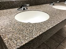 Modern bathroom with quartz countertop, two sinks and faucets with stone floor. Modern bathroom with quartz counter top, two sinks and faucets with stone floor stock photos