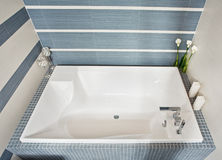 Modern bathroom with rectangular bath tub Stock Photos