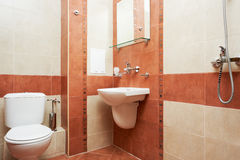 Modern bathroom in red color royalty free stock photography