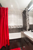 Modern bathroom with red curtains Royalty Free Stock Image