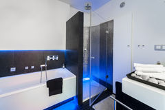 Modern bathroom with shower. Modern black and white bathroom with shower and bath Royalty Free Stock Images