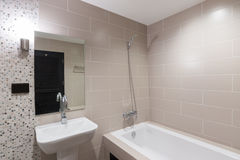 Modern bathroom with a shower and bathtub. Stock Photo