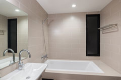 Modern bathroom with a shower and bathtub Stock Images
