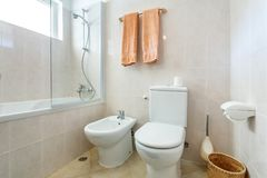 Modern Bathroom Shower Room With Toilet And Amenities. Stock Photo