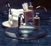 Modern bathroom sink. And faucet with rolled hand towels royalty free stock images