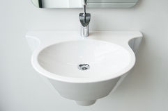 Modern bathroom sink and tap royalty free stock image