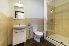 Modern bathroom with sinks, toilet Royalty Free Stock Images