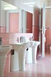 Modern bathroom sinks. Modern and very clean a bathroom sinks royalty free stock photos