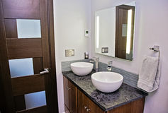 Modern bathroom. With stone vanity and two vessel sinks Royalty Free Stock Images