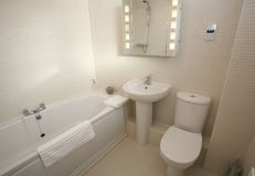 Modern Bathroom Suite Interior. Modern bathroom with white suite and chrome fittings Stock Photography