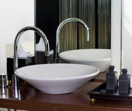 Modern bathroom tap and sink Stock Photo