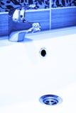 Modern bathroom taps Stock Images