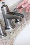 Modern Bathroom Taps in Brushed Nickel Stock Photo