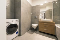 Modern bathroom with tiles on the floor. In stylish apartment Royalty Free Stock Photo