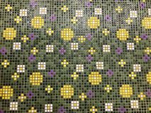 Small Mosaic with Flowers. Modern bathroom tiles with painted flowers in italian style Stock Photo