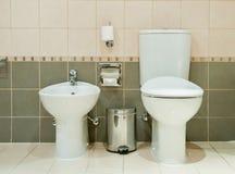Modern Bathroom with Toilet and Bidet. A modern bathroom equipped with a toilet and a bidet Stock Photo