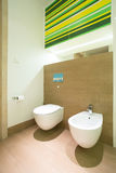 Modern bathroom with toilet and bidet Royalty Free Stock Photography