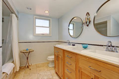 Modern bathroom with two oval mirrors, and white shower curtain. Royalty Free Stock Image