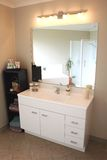 Modern Bathroom Vanity. A white and stainless steel modern bathroom vanity, mirror and accessories Stock Photography