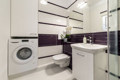 Modern bathroom in violet style Stock Images