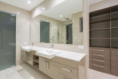 Modern bathroom with walk in robe Stock Image
