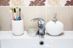 Modern bathroom washbasin with chrome faucet Royalty Free Stock Photography