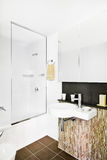 A modern bathroom with washbasin and toilet. A minimalist and compact design of bathroom to tiny spaces Stock Image