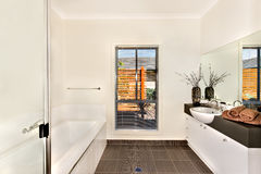 Modern bathroom with a water tub and bathing area opposite to th Royalty Free Stock Photo