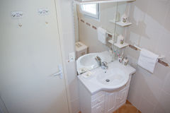 Modern Bathroom with a white bright Shower royalty free stock image