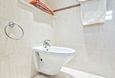 Modern bathroom with white ceramic bidets. Stock Images