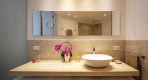 Modern bathroom with wood and marble finishes stock images