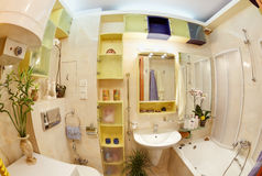 Modern Bathroom in yellow and blue vivid colors. Fisheye view stock photography