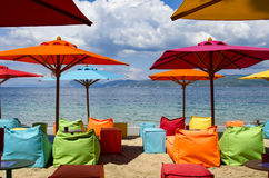 Colorful Beach umbrellas and deck chairs on the beach of Skiathos Greece royalty free stock photos