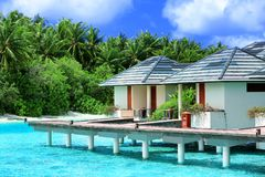 Modern beach houses on piles. At tropical resort royalty free stock images