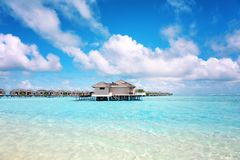 Modern beach houses on piles. At tropical resort royalty free stock photo